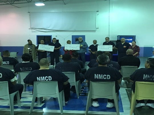 Otero County Prison Facility Inmates presented a check to the Chaparral organization Dec. 18, 2017.