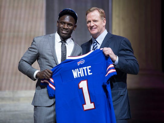 Roger Goodell presents Tre'Davious White with his first-round