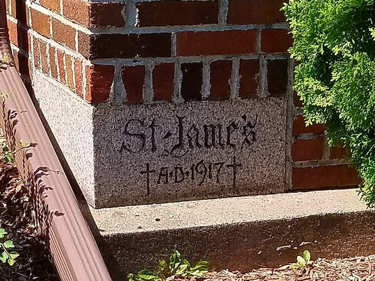 Pictured is the cornerstone of St. James' current Second Street church, which was laid in 1917.