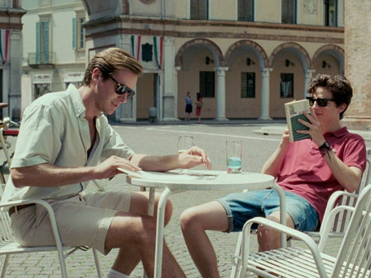 Elio (Timothée Chalamet, right) initially mistakes Oliver's (Armie Hammer) gruff flirtations for arrogance, but soon becomes enraptured after weeks spent exploring their sun-drenched Italian village.