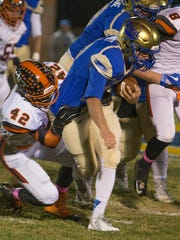 Reed running back Josiah Schmidt is tackled by Douglas'
