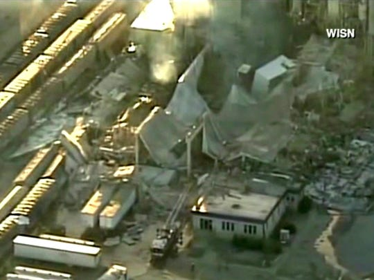 In this image taken from a video by WISN-TV, the rubble of a corn mill plant following an explosion is seen, Thursday, June 1, 2017, in Cambria, Wis. The sheriff in Columbia County said that the blast was reported around 11 p.m. Wednesday at the Didion Milling Plant in Cambria, about 80 miles northwest of Milwaukee.