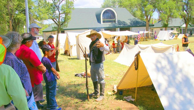 A volunteers talks about camp life with visitors to Fort Stanton LIVE.