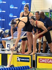 Georgia and Hali Flickinger, right, celebrates winning the 800 freestyle relay during the NCAA Championships at the McAuley Center in Atlanta, Ga., on Wednesday, March 16, 2016.