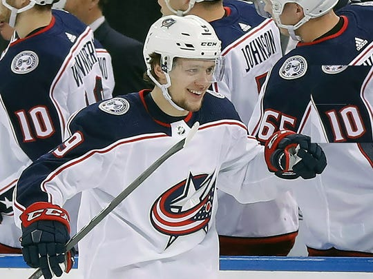 FILE - In this March 20, 2018, file photo, Columbus Blue Jackets left wing Artemi Panarin (9) is congratulated by teammates after scoring a goal against the New York Rangers during the second period of an NHL hockey game in New York. The New York Rangers' rebuild just took a giant leap forward. Winger Artemi Panarin, the top free agent available this offseason, signed a seven-year, $81.5 million deal to join the Rangers, a person with knowledge of the signing told The Associated Press on condition of anonymity because the team didn't announce terms of the deal Monday, July 1, 2019. (AP Photo/Julie Jacobson, File)