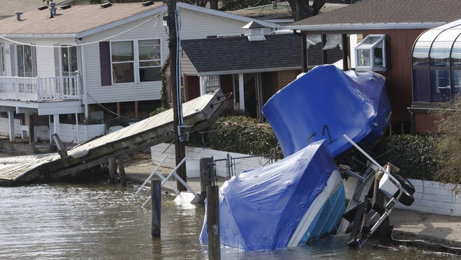 Boats remain washed up onto the shore at the Ba Mar Basin in Stony Point on Nov. 5, 2012.  ( Ricky Flores / The Journal News )