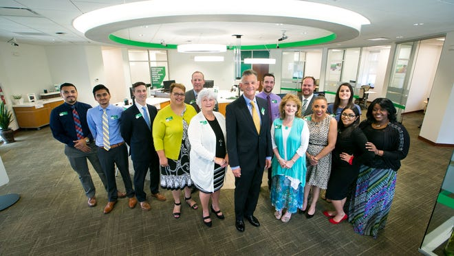 President and CEO of WSFS Bank, Mark A. Turner (center), along with executives and employees at the WSFS Bank branch on North Union Street in Wilmington.
