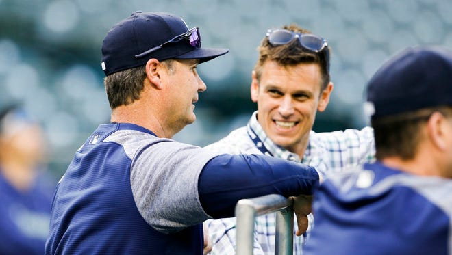 Mariners manager Scott Servais, left, talks with general manager Jerry Dipoto before a May game against the Oakland Athletics at Safeco Field.