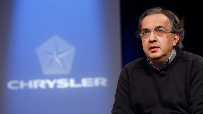 In this Dec. 17, 2009 file photo, Chrysler CEO Sergio Marchionne addresses the media during a news conference at the automaker's headquarters in Auburn Hills,