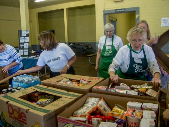 Volunteers sort through donations at the United Way