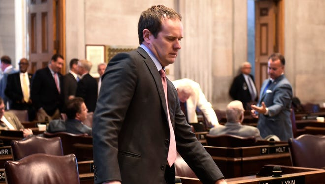 Rep. Jeremy Durham takes his seat at his desk in the House chambers during a special session Sept. 13, 2016, in Nashville. Durham was expelled from the legislature in September.