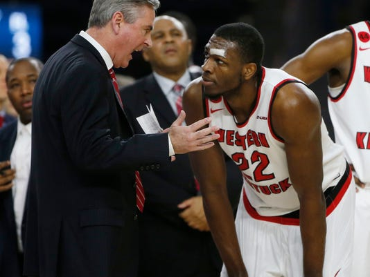 Western Kentucky head coach Rick Stansbury talks to Western Kentucky forward Dwight Coleby (22) as they played Marshall during the first half of the NCAA Conference USA Men's Basketball Championship Game in Frisco, Texas, Saturday, March 10, 2018. (AP Photo/Michael Ainsworth)