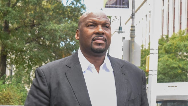 Chuck Person exits the Federal Courthouse in Manhattan.