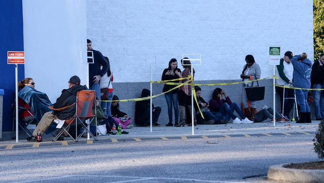Black Friday shoppers line up for the opening of Toys R Us in Anderson on Thursday, as the store was about to open at 5 p.m.