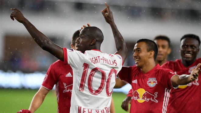 New York Red Bulls forward Bradley Wright-Phillips, center, celebrates his goal during the first half of the team's MLS soccer match against D.C. United, Wednesday, July 25, 2018, in Washington.