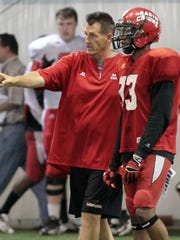 UL assistant coach David Saunders is shown here giving instruction to UL defensive back Trevence Patt (33).