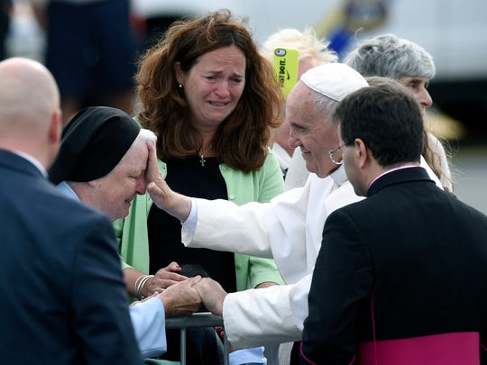 Pope Francis stops to meet people after arriving at