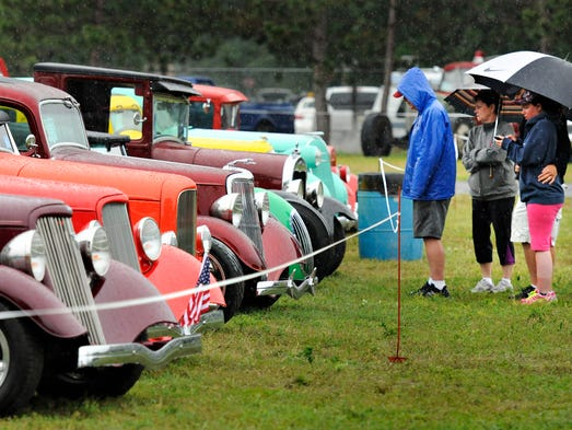 Despite the rain, people checked out the antique cars at the 39th Annual Pantowners St. Cloud Antique Auto Club Car Show and Swap Meet.