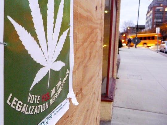 "A sign in Burlington advocates a ""yes"" vote for a non-binding referendum on cannabis legalization on Nov. 6, 2012."