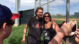 "Bronson Arroyo takes a photo with a fan at the Reds' ""B"" game Thursday against the Diamondbacks."