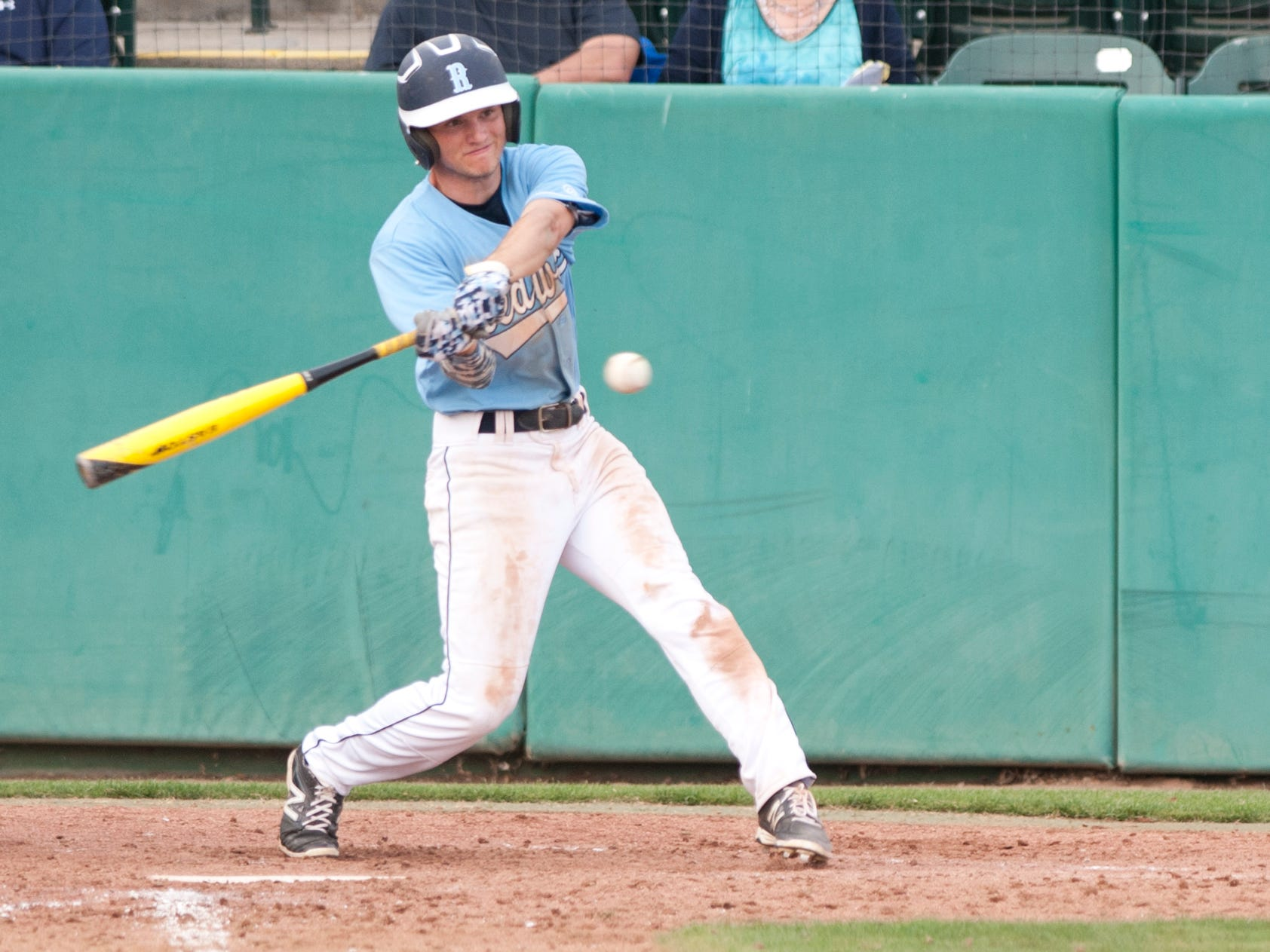 Redwood's Tyler Garster bats against Clovis East in a non-league game at Recreation Park on March 10.