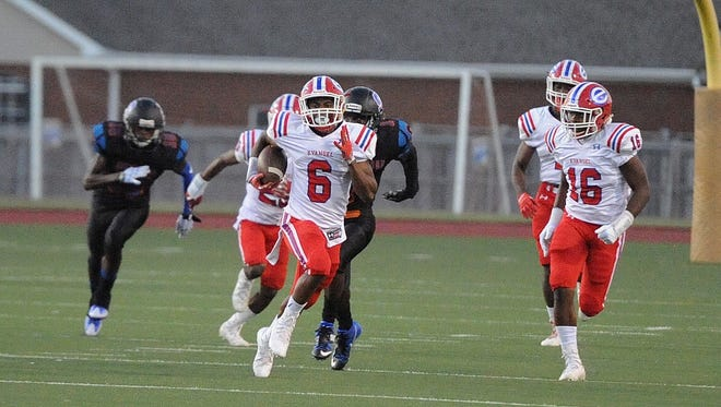 Evangel's Orlando Puryear (6) tries to outrun the Southwood defense.