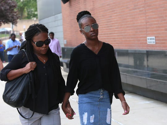 Trinity Carr, 16, (right) is one of three girls charged in the fatal assault of Howard High School of Technology student Amy Joyner-Francis. Carr walks into the New Castle County Courthouse Monday morning, Aug. 8, 2016, to have a judge determine whether she will be tried as an adult.