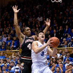 Donovan Mitchell of the Louisville Cardinals defends Grayson Allen of the Duke Blue Devils during their game at Cameron Indoor Stadium.