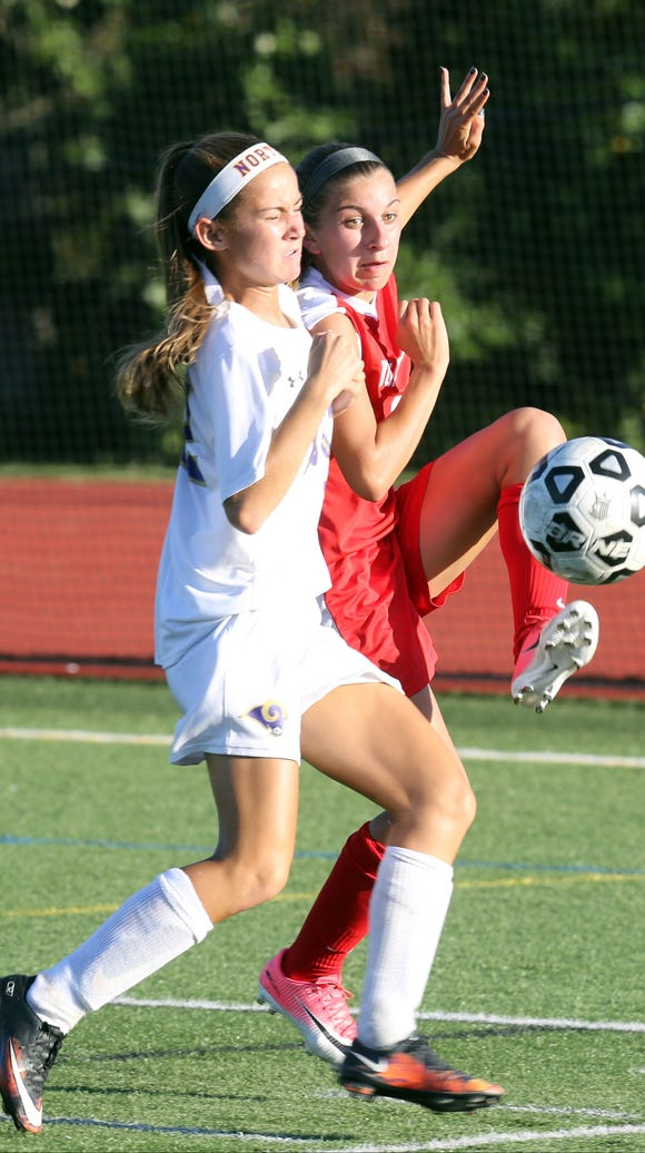 Clarkstown North's Meghan McKiverkin (22) and North