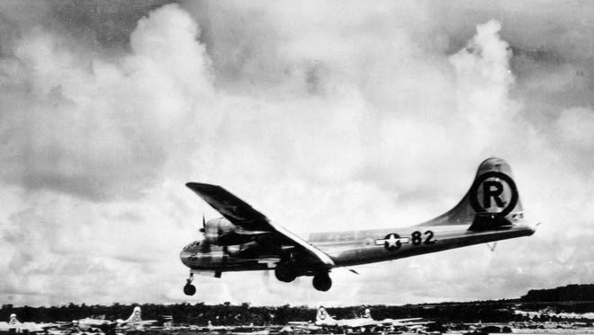 The B-29 bomber Enola Gay lands on Tinian after dropping an atomic bomb on Hiroshima, Japan, in August 1945.