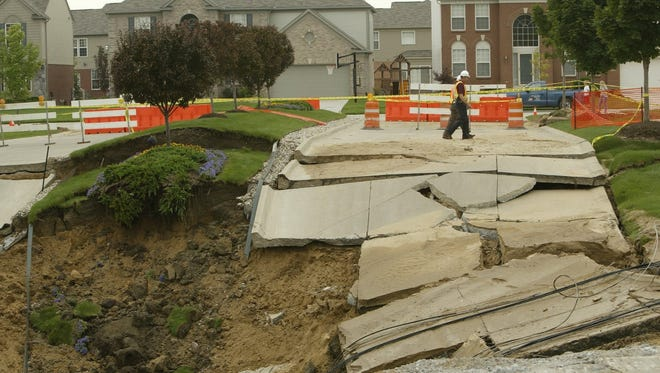 This August 2004 file photo  shows a sinkhole at the entrance to the Villa Fontana subdivision at the intersection of Fontana Blvd and 15 Mile Road in Sterling Heights.