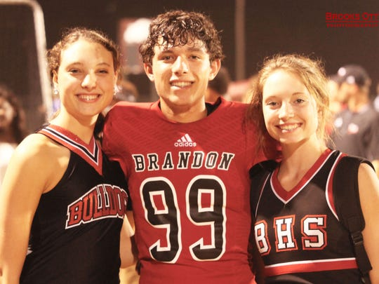 Tony and Missy Goodman's triplets have handled their mom's cancer diagnosis in different ways.  From left), Sydney, Scott and Jaime are sophomores at Brandon High School.