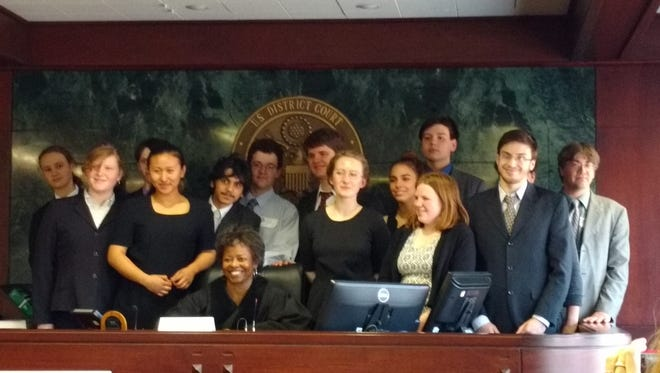 The Lehman Alternative Community School mock trial team. Members are  Back row: Liam Stark, Alec Simmons, Pierre St. Perez, Ian Cullings,  August Ryan, Caitlin Mallory (obscured), Michael Nardi Front Row: Sophie Fields, Eh Tha Youi Lee, Pierre St. Perez, Judge Vanessa Bogan, Captain Emily Murphy, Ella Louise, Maggie LaChance, Joshua Machlin