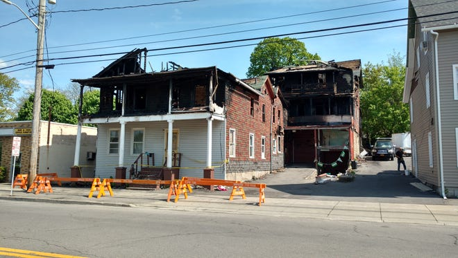 The building at 162 Henry St. was damaged by a fire in March. It is now the city's list of properties it  plans to demolish in 2016, according to Mayor Richard David.