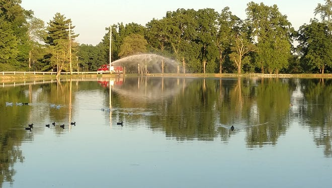 Firefighters aerate a pond at Henry County Memorial Park in response to a suspected algal bloom and a fish kill.