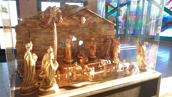 The manger scene was made from a 400-year-old olive tree.