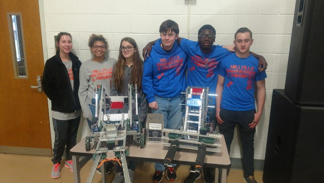 Members of Millville High School's Engineering and Robotics Club, (from left) Maggie Mayfield, Brianna File, Chrissy Zimmerman, Tristan Cossaboon, Nyshawn Burton and Matt Harris, competed in their first robotics competition on Jan. 14 at Cape May County Technical High School.