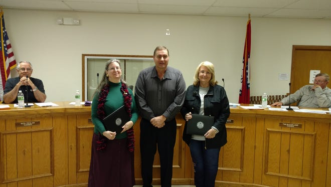 Gassville City Council members Naomi Lassen, left and Anita Seaman, right, were recognized at the Arkansas Municipal League winter conference for completing 21 hours of training to become certified municipal officials. Pictured presenting their certificates is Gassville Mayor Jeff Braim.