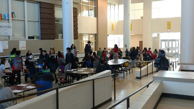 Battle Creek Central High School students walk into the Commons area under the direction of a teacher Thursday.