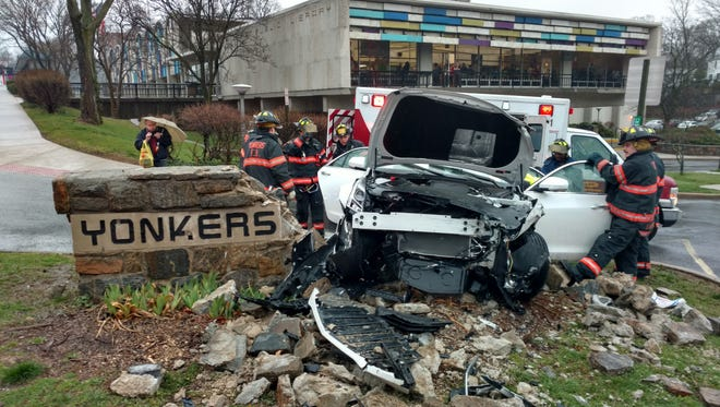 """A woman lost control of her car on April 6, 2017, at the Grinton I. Will Library in Yonkers, destroying the """"iconic"""" sign."""