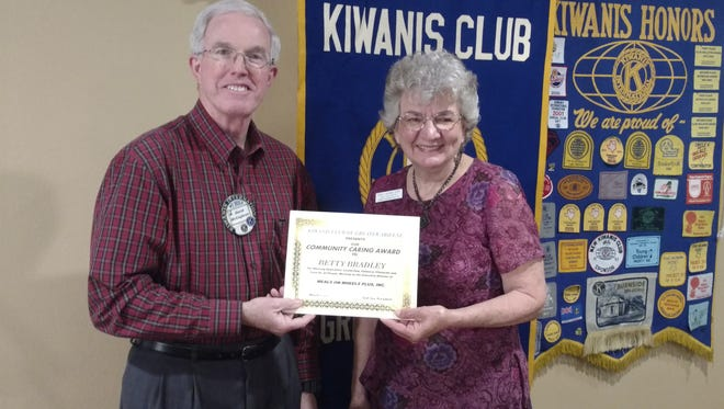 David McCaghren of the Kiwanis Club of Greater Abilene presents the March Community Caring Award to Betty Bradley.