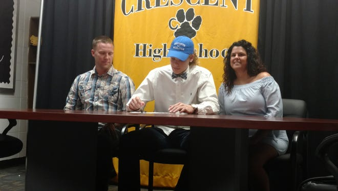 Crescent's Gavin Sears signs a national letter of intent with Southern Wesleyan on Tuesday.