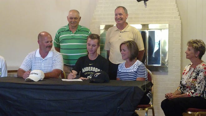 Colt Martin signs to play golf at Anderson University during a ceremony Wednesday at Boscobel.