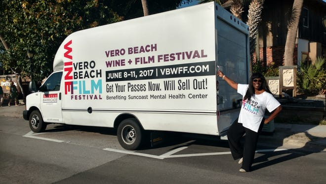 """Festival founder Jerusha Stewart with one of her """"street ads/"""""""