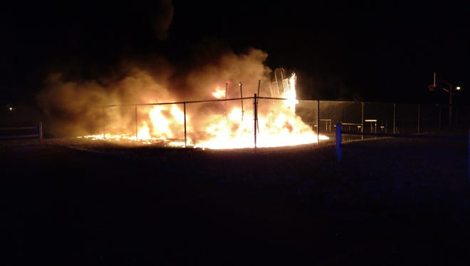 Fire engulfs playground equipment Monday night.