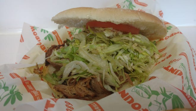 The carnitas torta at Rainbow Fountain Tortas is a good way to celebrate Sandwich Day on the border.