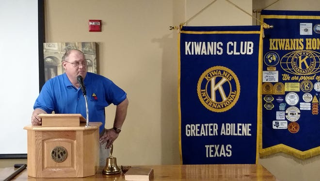 William Lenches, of the 12th Armored Division Memorial Museum, speaks to the Kiwanis Club of Greater Abilene.