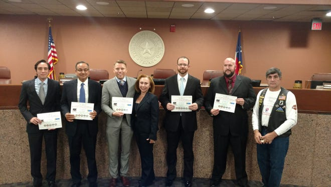 From left, County Commissioner Vince Perez, County Commissioner Carlos Leon, County Judge Ruben Vogt, County Clerk Delia Briones, County Commissioner David Stout, County Commissioner Andrew Haggerty and Darrell G. Mond.