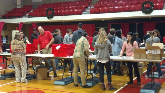About 50 Rutgers student volunteers Thursday helped prepare the university's College Avenue Gymnasium for registration, toy drop-off, and race bib/shirt pick-up for Saturday's Big Chill 5K.