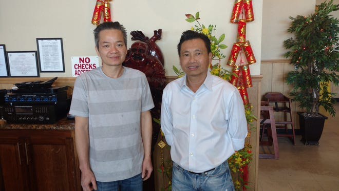 Hung Ngo, who owns Viêt Restaurant and Quyet Bui, a staffer, are proud the restaurant was named Best in Texas by Yelp.